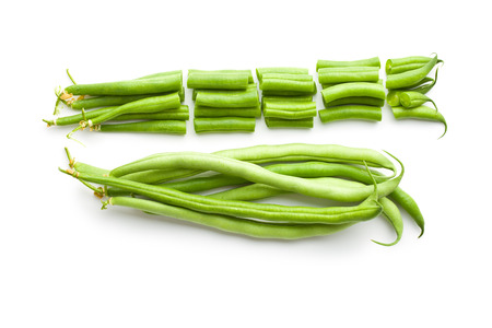 isolated on green: chopped green beans on white background