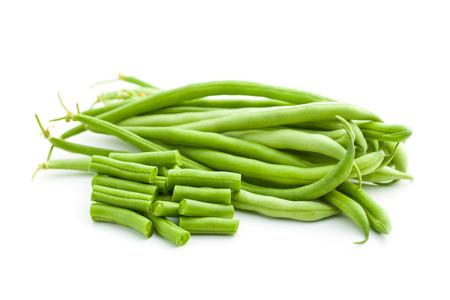 ejotes: jud�as verdes cortadas en el fondo blanco Foto de archivo