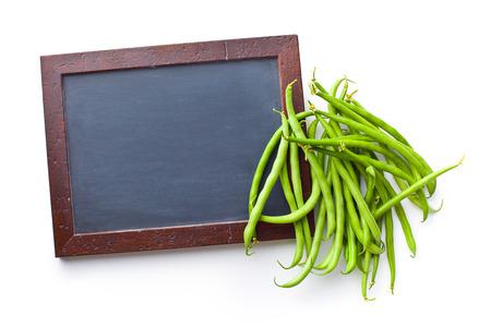 green beans: las jud�as verdes con pizarra Foto de archivo