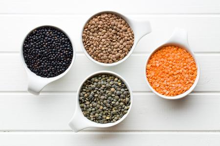 the various lentils in ceramics bowls