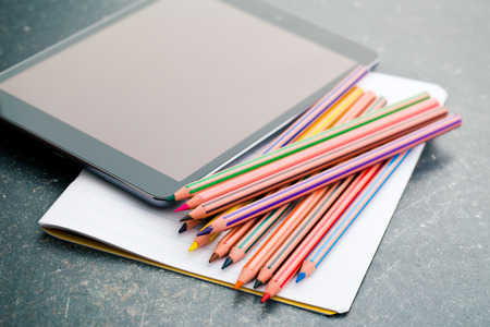 blank tablet: colored pencil , blank notebook and computer tablet on work table Stock Photo