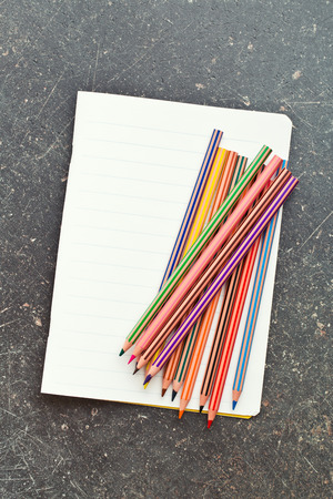 colour pencils: the colour pencils and blank workbook Stock Photo