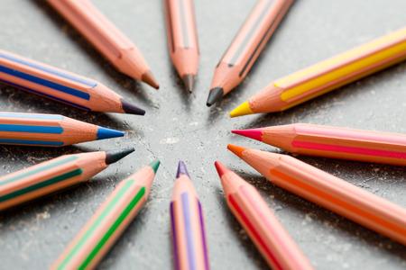 colour pencils: colour pencils on work table Stock Photo