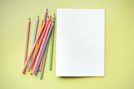 workbook: the colour pencils and blank workbook Stock Photo
