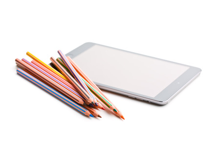 white colour: colour pencils and computer tablet on white background