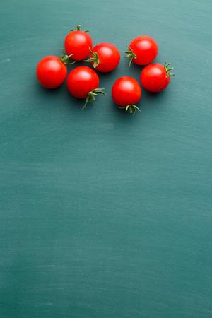 green chalkboard: red tomatoes on green chalkboard Stock Photo