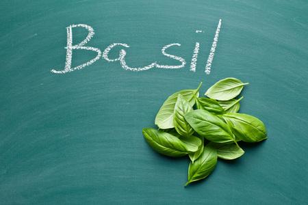 green chalkboard: basil leaves on green chalkboard
