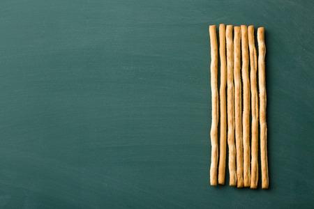 grissini: breadsticks grissini on chalkboard