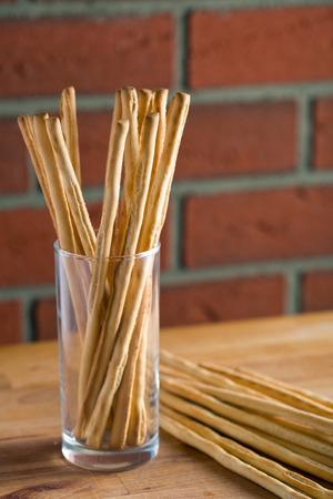 breadsticks: breadsticks grissini on kitchen table