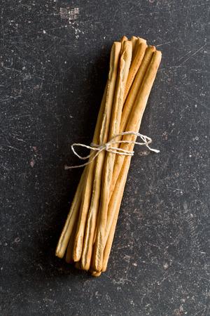 breadstick: breadsticks grissini on black table