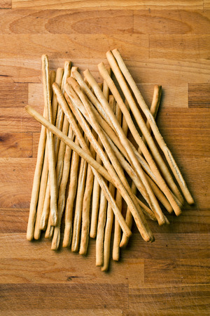 gressins: breadsticks grissini on old wooden table