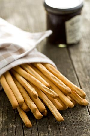 pretzel stick: breadsticks grissini on old wooden table