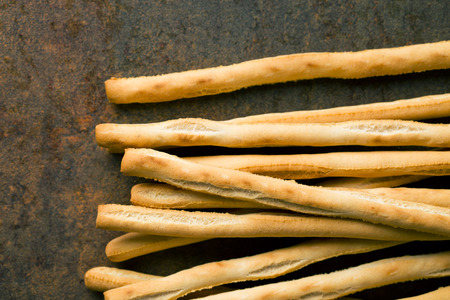 gressins: breadsticks grissini on kitchen table