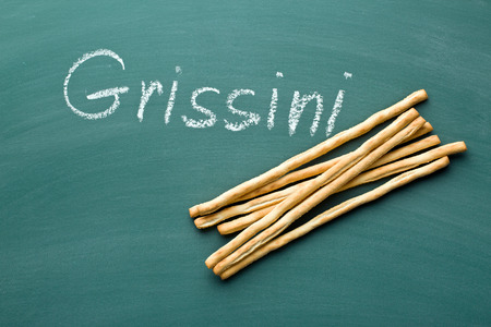 pretzel stick: breadsticks grissini on chalkboard