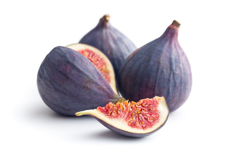 sliced fresh figs on white background Banco de Imagens