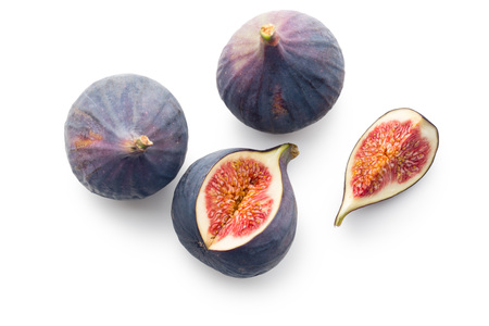 exotic fruits: sliced fresh figs on white background Stock Photo