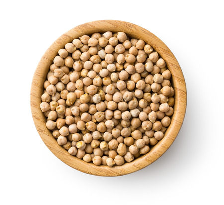 uncooked chickpeas in wooden bowl Stock Photo