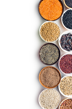 various legumes in bowls on white background