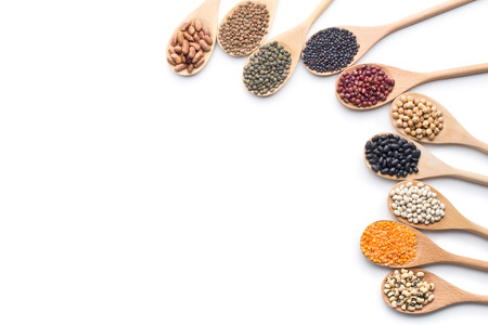 various dried legumes in wooden spoons on white background Banque d'images