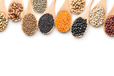 various dried legumes in wooden spoons on white background 版權商用圖片