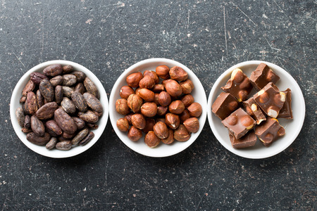 cocoa beans: chocolate, hazelnuts and cocoa beans on kitchen table