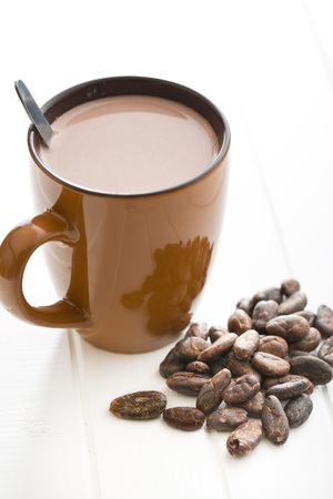 bean: the cocoa drink and cocoa beans on kitchen table Stock Photo
