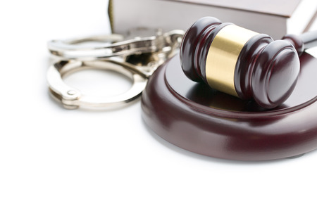 criminal: handcuffs and judge gavel on white background