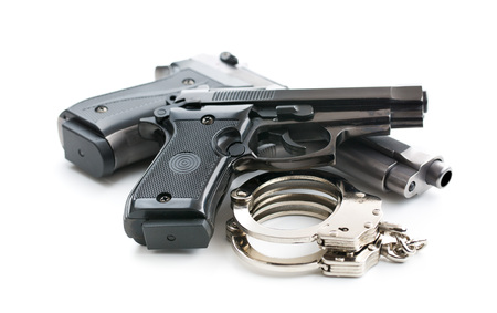 handguns: handguns and handcuffs on white background Stock Photo