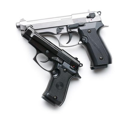 白い背景の上の 2 つの拳銃 写真素材