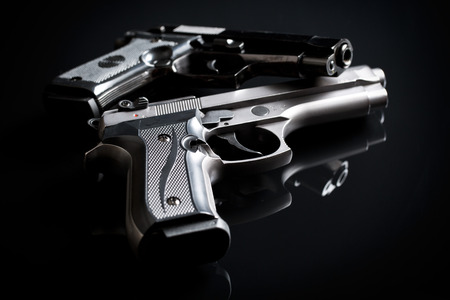 9mm: two handguns on black background Stock Photo