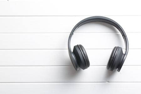 Wireless headphones on white table 版權商用圖片