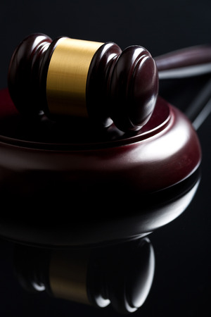 defendant: the judge gavel on black background