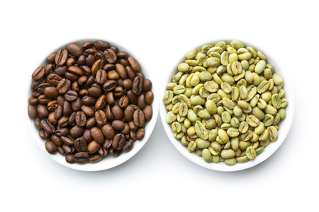 unprocessed: roasted and unroasted coffee beans in bowls