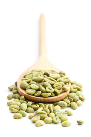 green bean: green coffee beans in wooden spoon on white background