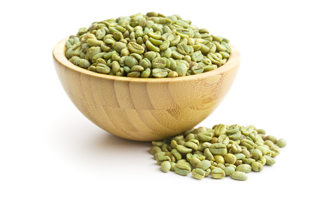 ejotes: green coffee beans in wooden bowl on white background
