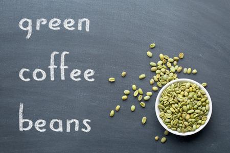 green bean: unroasted green coffee beans on blackboard