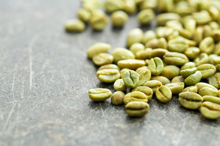 unroasted: unroasted coffee beans on old table Stock Photo