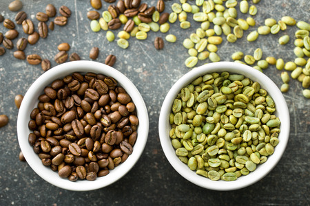 unroasted: top view of unroasted and roasted coffee beans