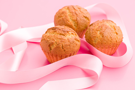muffin: sweet muffins on pink background Stock Photo