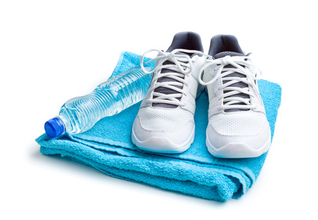 sport concept. bottle, shoes and towel on white background Banco de Imagens