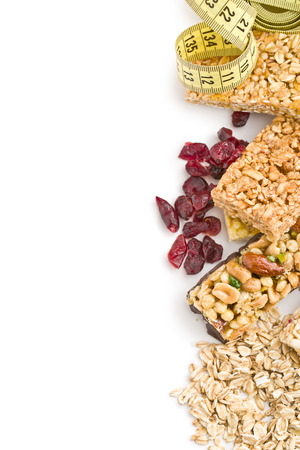 white bars: muesli bars with raisins and oat flakes on white background