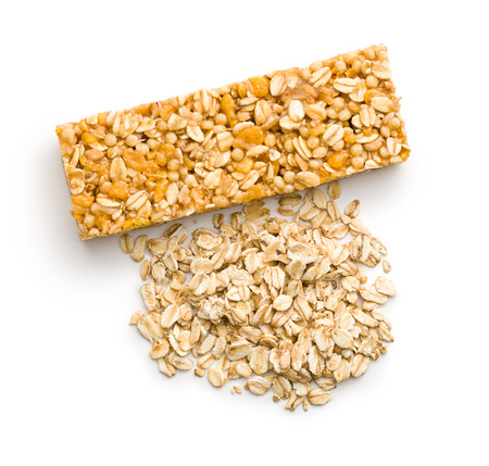 cereal bar: muesli bar and oat flakes on white background