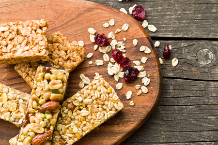 oats: muesli bars on old wooden table Stock Photo