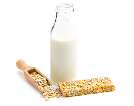 granola bar: muesli bar and milk in glass bottle