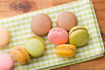 pastries: tasty colorful macarons on wooden table Stock Photo