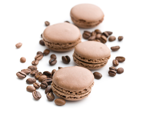 coffee beans: macarons with coffee flavor and coffee beans on white background