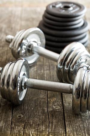 kilos: iron dumbbells on old wooden background