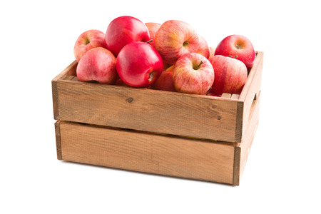 red box: red autumn apples in wooden box on white background