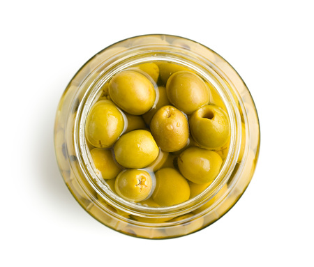 pitted green olives in jar Banco de Imagens