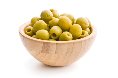 pitted: pitted green olives in bowl on white background